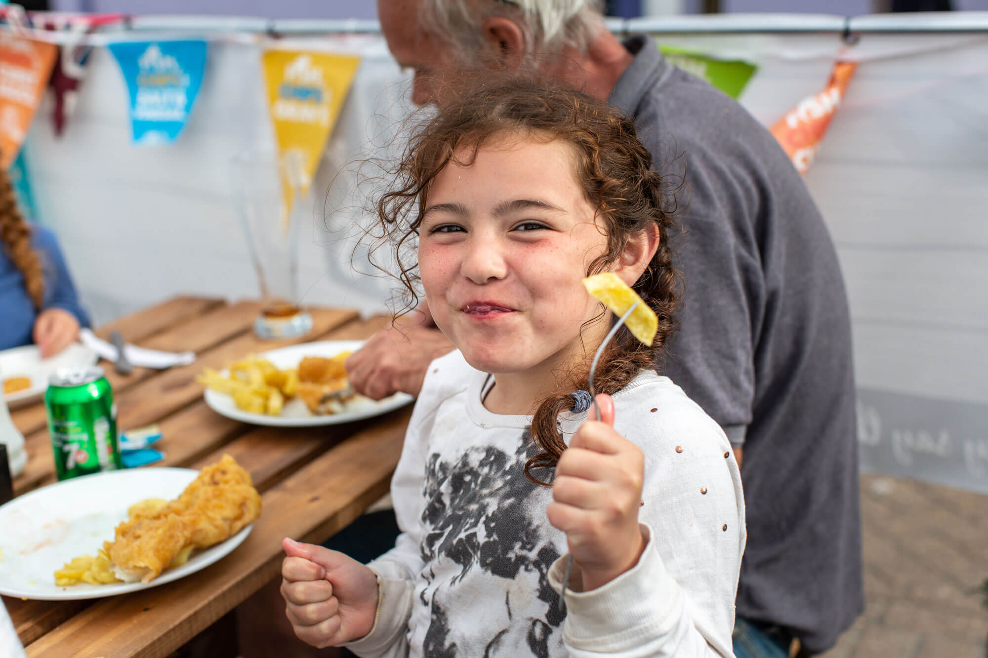 Young-girl-enjoying-Fish-and-Chips